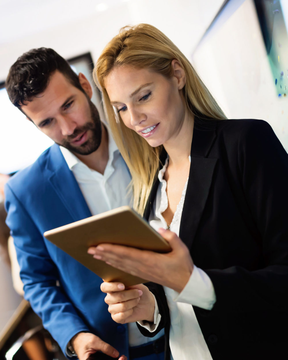 Employees looking at sales forecasting system