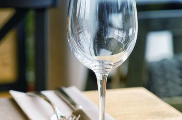 glass on table at restaurant financial planning